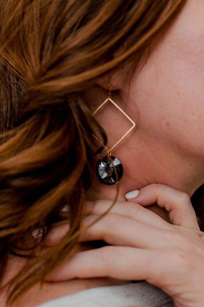 Woman Models Black & Gold Earring For Frock Asheville NC